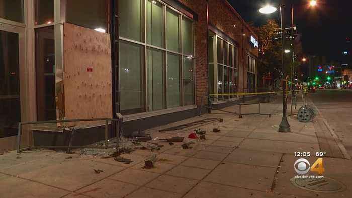 Car Crashes Through Building, Damages It