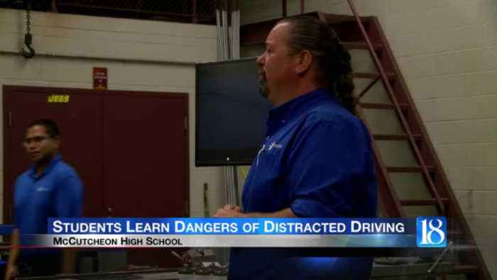 McCutcheon High School students participate in distracted driving simulator
