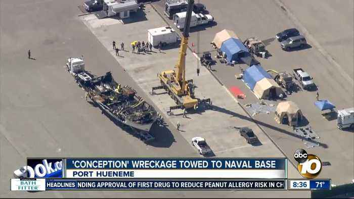Wreckage of boat involved in deaths of 34 people towed to naval base