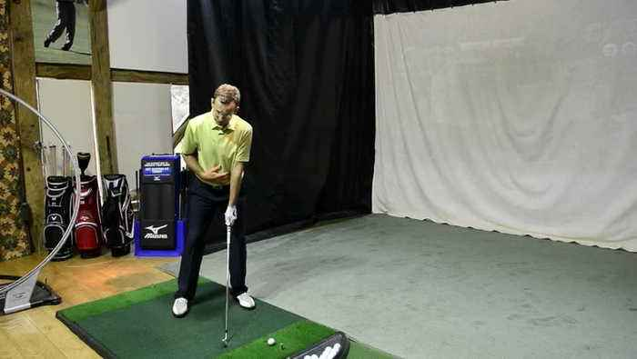 What is the stack and tilt golf swing?