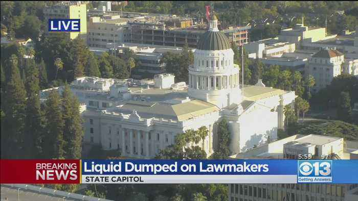 Red Liquid Dumped On Lawmakers