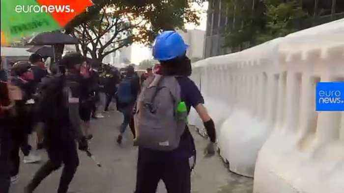 Hong Kong riot police fire tear gas at anti-government protesters