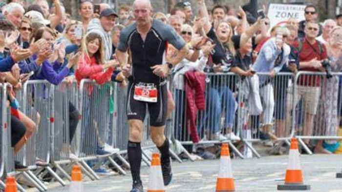 Gareth Thomas competes in Ironman Wales
