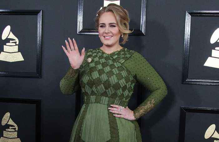 Adele to release upbeat track about divorce