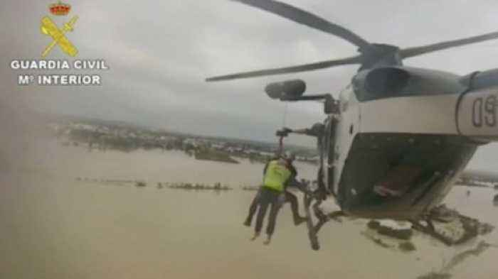 Video Shows Spanish Police Rescuing Flood Victims with Helicopter Crew