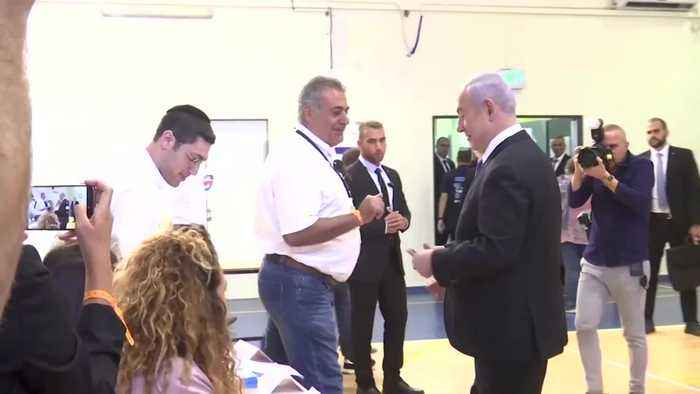 Netanyahu votes in election that could end his domination of national politics
