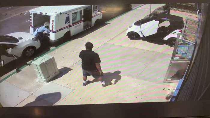 Car Slams into Postal Worker