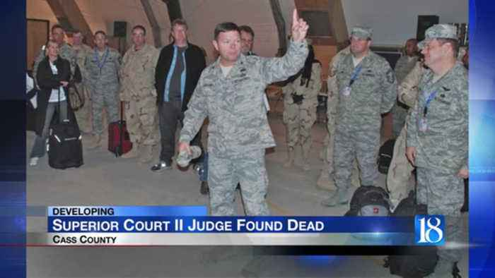 Cass County judge dies after being pinned under car