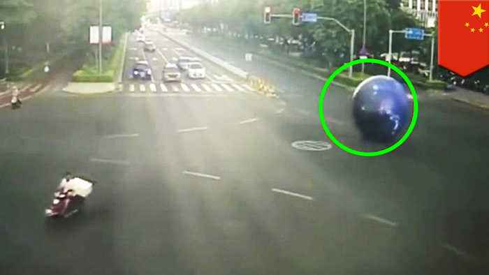 Massive moon rolls down the road, so man gives chase