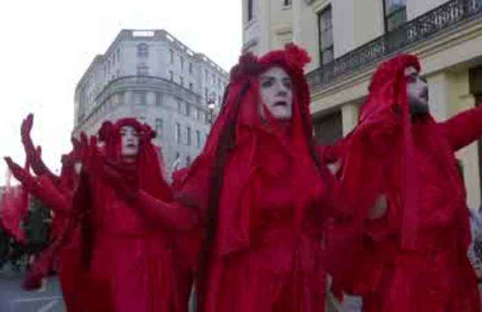 Climate activists stage funeral at London Fashion Week