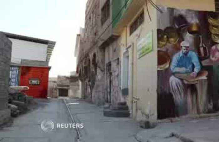 Young artists are splashing color back onto Mosul