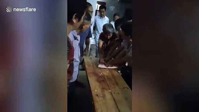Group of women fight over the last piece of discounted meat at Chinese market