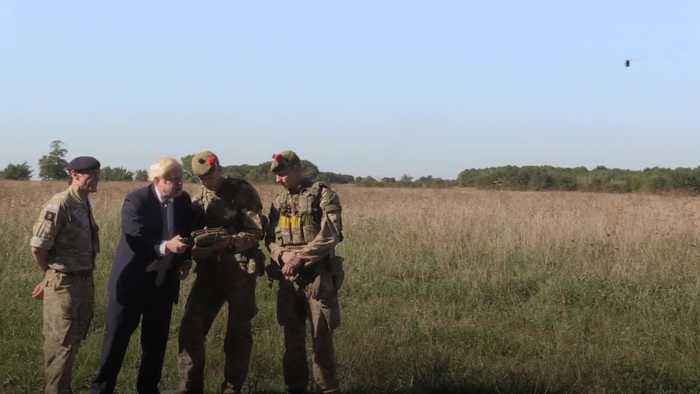 Boris Johnson operates drone during British Army visit