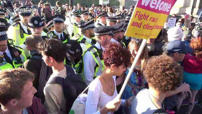 Scuffles as climate change protesters CLASH with police in London