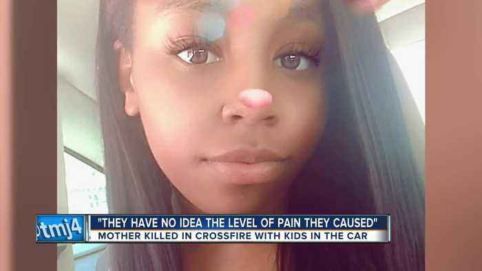 Mother killed in crossfire with kids in the car