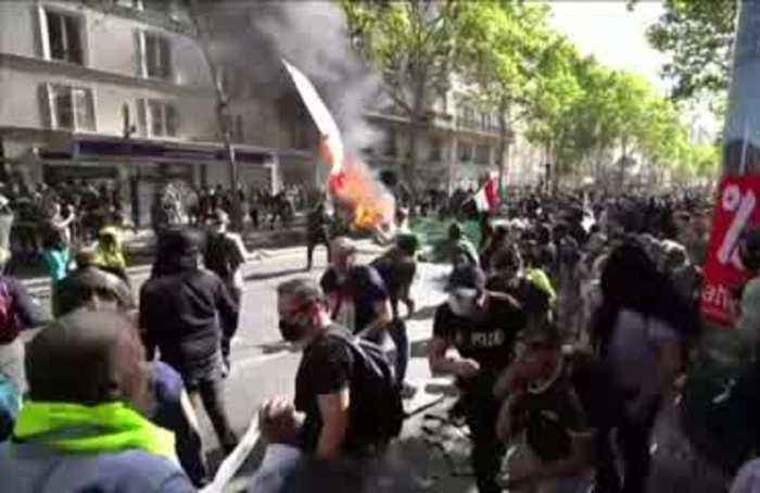 Tear gas and violence as police clash with protesters in central Paris