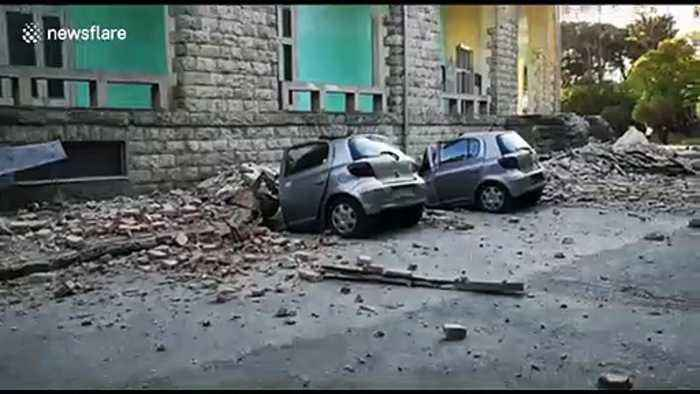 Destroyed cars lie next to damaged building after earthquake hits Tirana, Albania