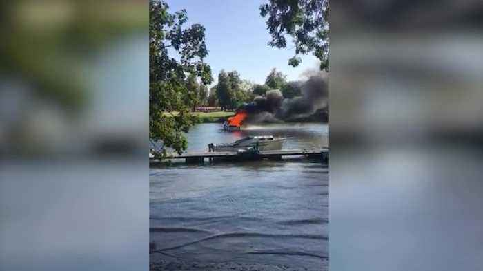 Boat engulfed in flames on River Thames