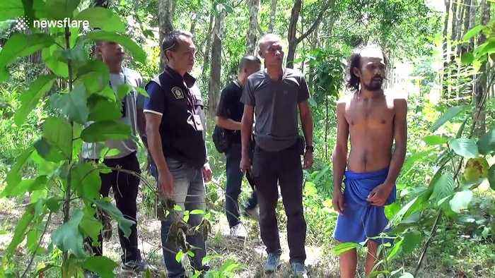 Thai father keeps epileptic teenage son chained to tree to 'stop him from wandering away'