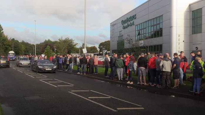 Laid-off Wrightbus workers demonstrate outside church