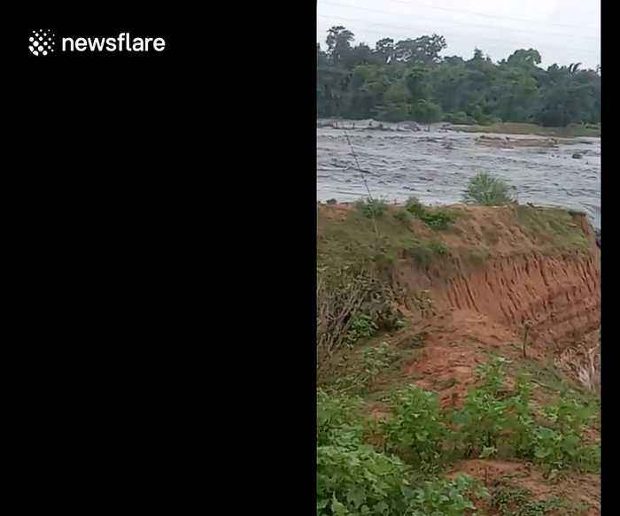 Dramatic moment river changes course and plunges into huge coal mine in India