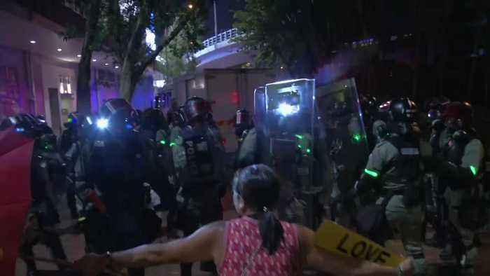 Hong Kong: Woman falls on ground as liquid sprayed into face
