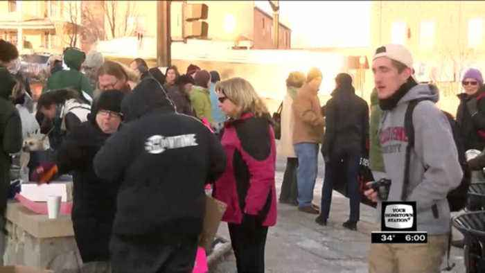 Group rallies against temporary halt to U.S. refugee program