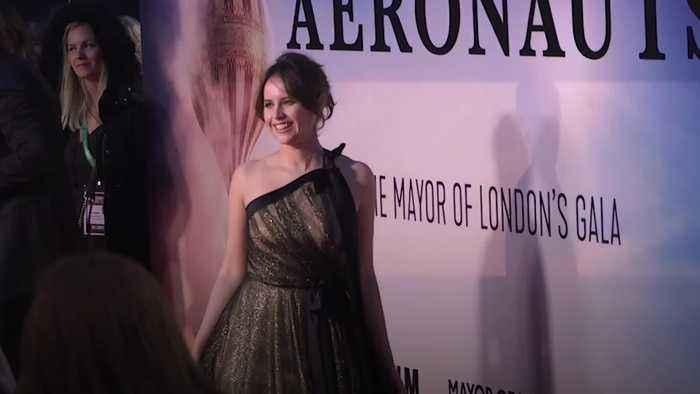 Felicity Jones and Eddie Redmayne reunited at Aeronauts premiere