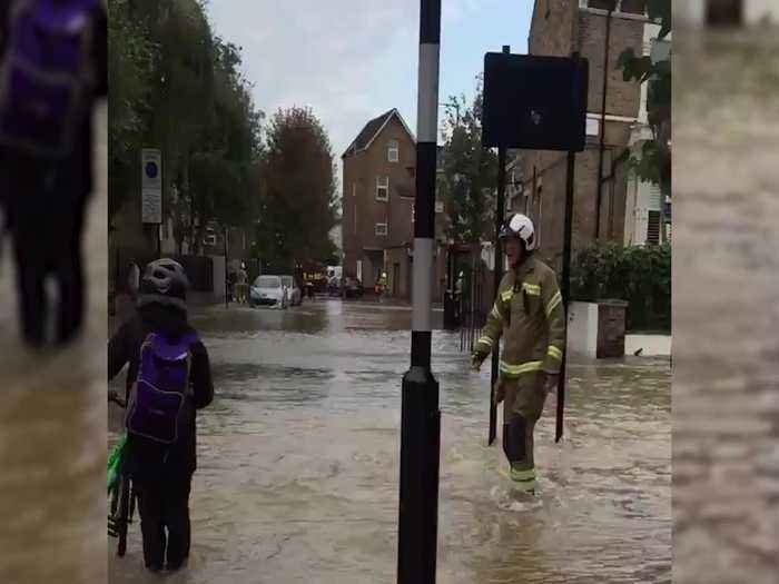 Firefighters evacuate residents as burst water main floods London street