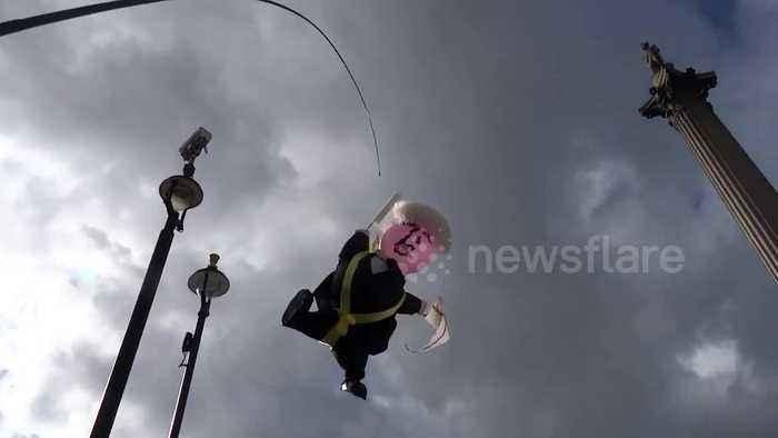 Boris Johnson balloon spotted flying over Extinction Rebellion camp in Trafalgar Square