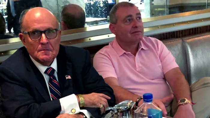 Two men linked to Trump's lawyer Giuliani arrested