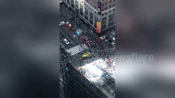 NYC Extinction Rebellion protestors show up in a boat and shut down Times Square