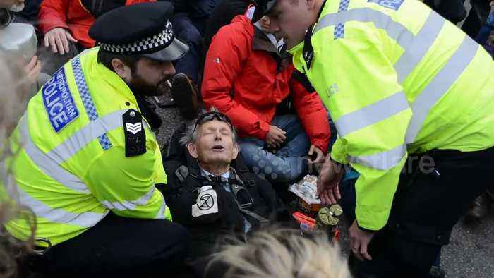 Extinction Rebellion protesters arrested as roof invader removed by police at London City Airport