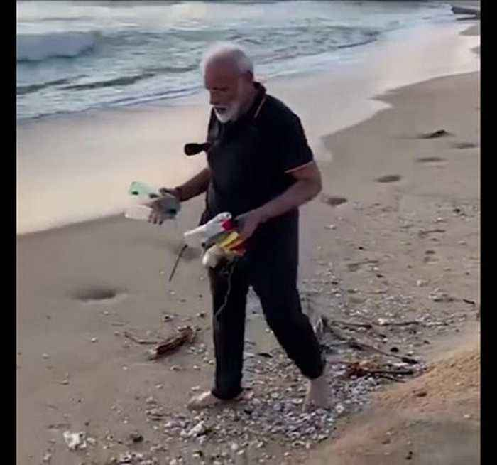 India Prime Minister Narendra Modi helps clear beach of rubbish
