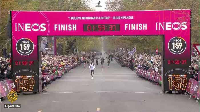 Kenya's Eliud Kipchoge finishes marathon in less than two hours