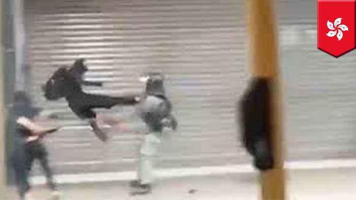 Hong Kong protester destroys policeman with flying kick