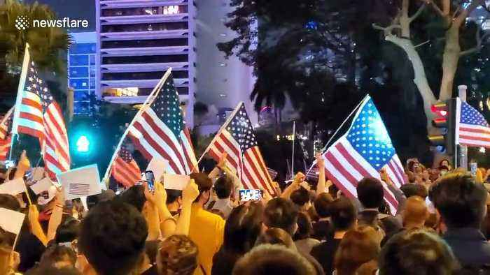 Thousands of pro-democracy protesters throng Hong Kong's Chater Garden waving US flags