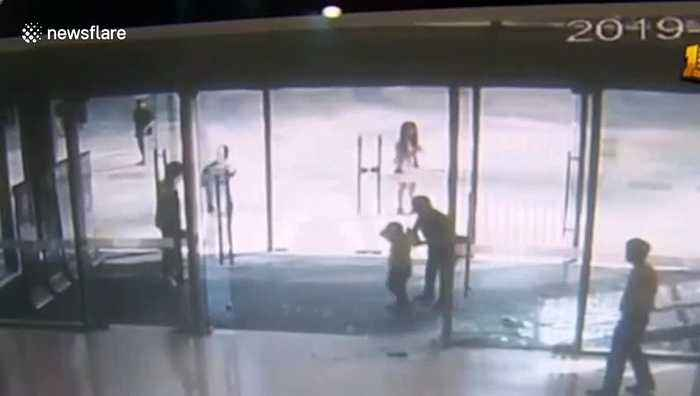 Glass door shatters on boy after he gives it a shove at mall in China