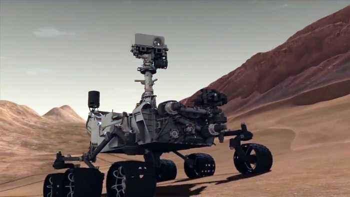 Mars Orbiter Spots Both NASA Lander And Rover On Red Planet