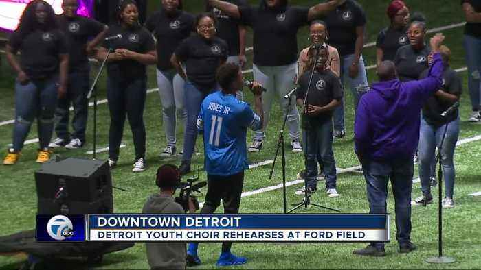 Lions wide receiver Marvin Jones, Jr. joins Detroit Youth Choir for practice at Ford Field