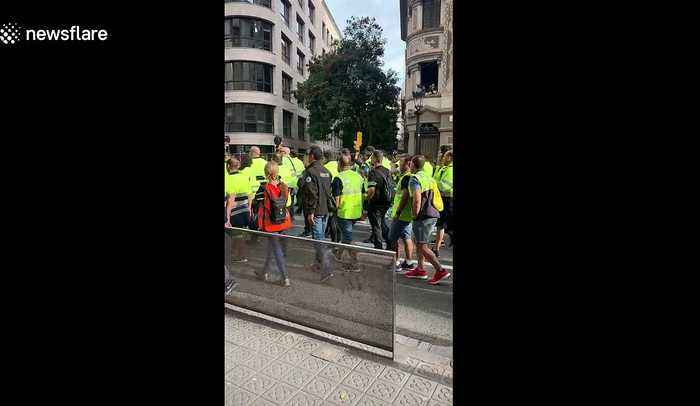 General strike begins as workers march through the centre of Barcelona