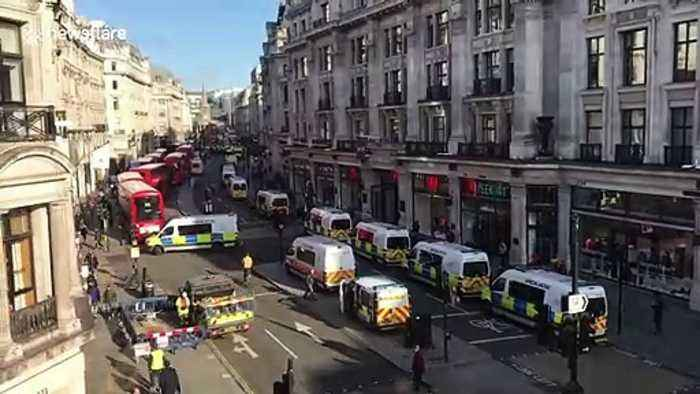 Large police presence as Extinction Rebellion block Oxford Circus with massive wooden structures