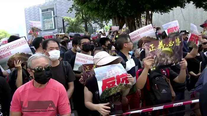Tens of thousands protest in illegal Hong Kong march