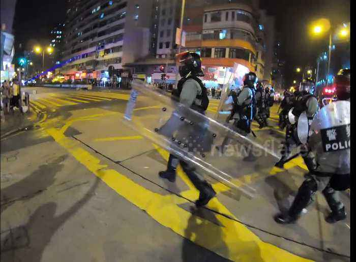 Hong Kong police clear street of blockades set up by protesters