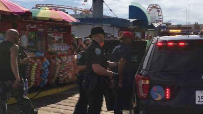 Man in MAGA Hat Arrested After Allegedly Dousing Demonstrators With Bear Spray at Santa Monica Pier