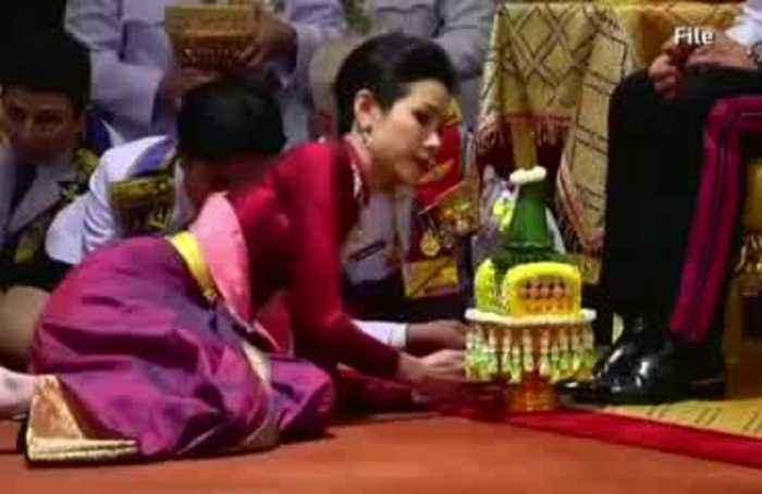 Thai king strips 'disloyal' consort of her titles