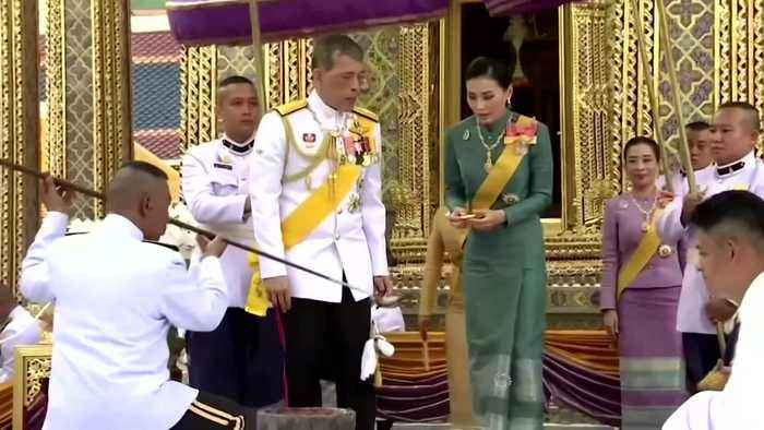 Thai king strips 'disloyal' consort of her titles