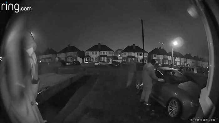 Brazen car thieves caught on camera laughing as they steal Audi from driveway