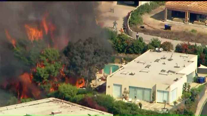 Evacuations Lifted After Fire Damages Multimillion-Dollar Homes in Los Angeles