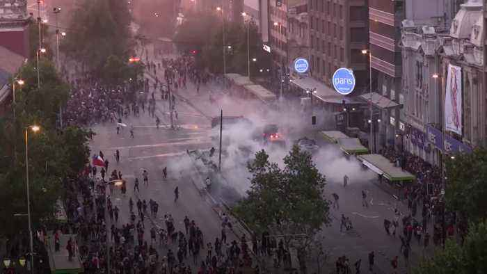 Police use tear gas and water cannons to disperse violent protests in Chile